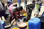 Residents of Epworth wait to fetch water at a borehole in Harare, Tuesday, Sept, 24, 2019.The more than 2 million residents of Zimbabwes capital and surrounding towns are now without water after authorities shut down the citys main treatment plant, raising new fears about disease after a recent cholera outbreak while the economy crumbles further.(AP Photo/Tsvangirayi Mukwazhi)