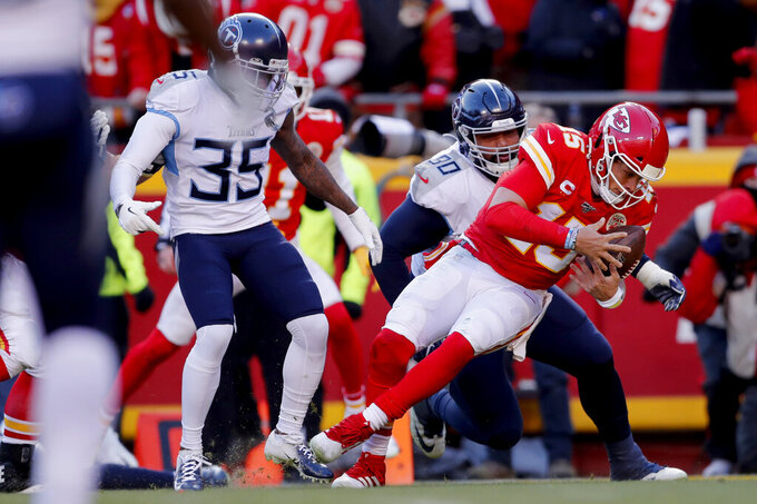 Kansas City Chiefs' Patrick Mahomes runs for a touchdown past Tennessee Titans defensive tackle DaQuan Jones (90) and cornerback Tramaine Brock Sr. (35) during the first half of the NFL AFC Championship football game Sunday, Jan. 19, 2020, in Kansas City, MO. (AP Photo/Jeff Roberson)