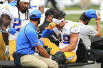 Los Angeles Chargers linebacker Drue Tranquill (49) is carted off the field during the first half of an NFL football game against the Cincinnati Bengals, Sunday, Sept. 13, 2020, in Cincinnati. (AP Photo/Aaron Doster)