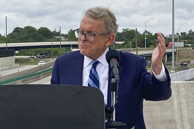 FILE - In this July 13, 2021 file photo, Ohio Gov. Mike DeWine promotes a new entrance ramp onto I-70 in downtown Columbus, Ohio. DeWine says Democratic President Joe Biden made a mistake in ordering new federal vaccine requirements. He says the country should focus on the science of preventing the spread of the coronavirus, arguing the vaccine is the best tool to do that. But he said Friday, Sept. 10, 2021 that people and business owners should make their own decisions about vaccination. (AP Photo/Andrew Welsh-Huggins, File)
