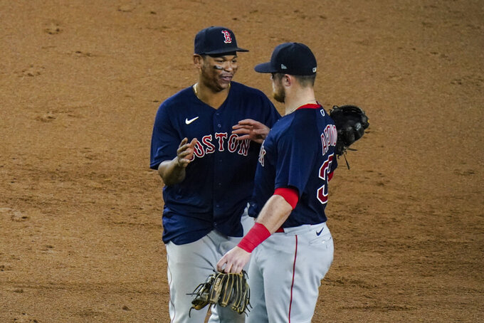 Boston Red Sox's Rafael Devers, left, celebrates with teammate Christian Arroyo after a baseball game against the New York Yankees, Friday, June 4, 2021, in New York. (AP Photo/Frank Franklin II)