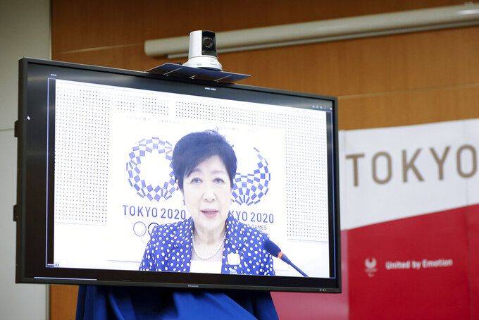 Tokyo Governor Yuriko Koike speaks remotely during a four-party meeting in Tokyo, Monday, Aug. 16, 2021. All fans will be barred from the Paralympics during the pandemic, just as they were from the recently-completed Tokyo Olympics, organizers said Monday. (Rodrigo Reyes Marin/Pool Photo via AP)