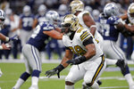 New Orleans Saints defensive tackle Sheldon Rankins (98), in his first game of the season after being injured last season, pursues in the first half of an NFL football game against the Dallas Cowboys in New Orleans, Sunday, Sept. 29, 2019. (AP Photo/Bill Feig)