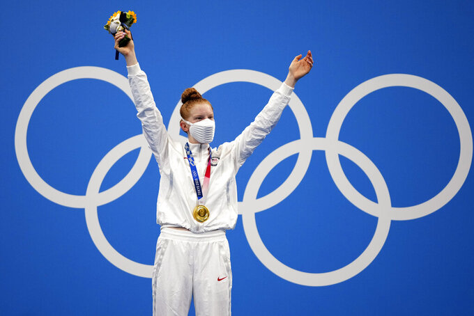 Gold medalist Lydia Jacoby of the United States celebrates on the podium after the final of the women's 100-meter breaststroke at the 2020 Summer Olympics, Tuesday, July 27, 2021, in Tokyo, Japan.(AP Photo/Matthias Schrader)