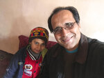 This photo provided by Bahaudin Mujtaba shows Noman Mujtaba, left, and Bahaudin Mujtaba in Kabul, Afghanistan, on Dec. 21, 2017. The boy, now 10 years old, is a distant relative of Mujtaba, who lives in Florida and is trying to adopt him and bring him to the United States. (Courtesy of Bahaudin Mujtaba via AP)