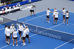The Springfield Lasers, left, and Orlando Storm, right, are introduced at the start of the World Teamtennis tournament at an empty tennis arena at The Greenbrier Resort Sunday July 12, 2020, in White Sulphur Springs, W.Va. (AP Photo/Steve Helber)