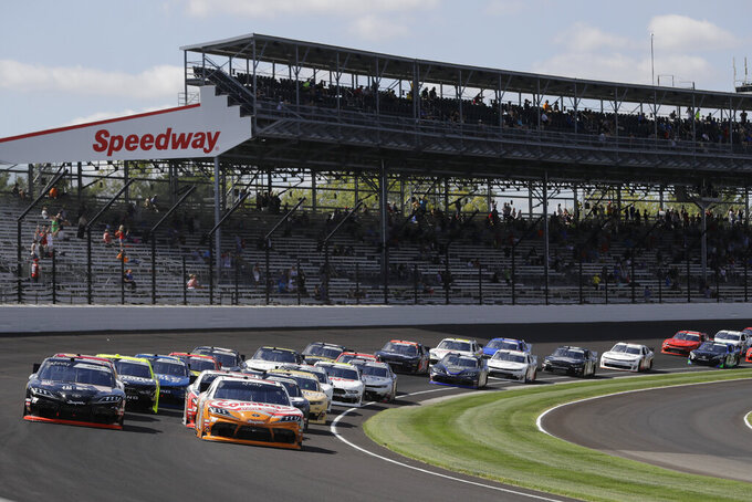 NASCAR Xfinity Series driver Kyle Busch (18) leads the field into turn one for the start of the NASCAR Xfinity auto race at the Indianapolis Motor Speedway, Saturday, Sept. 7, 2019 in Indianapolis. (AP Photo/Darron Cummings)