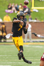 Missouri quarterback Kelly Bryant throws a pass during the second quarter of an NCAA college football game against Troy Saturday, Oct. 5, 2019, in Columbia, Mo. (AP Photo/L.G. Patterson)