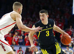 Oregon guard Payton Pritchard (3) drives on Arizona forward Ryan Luther in the first half of an NCAA college basketball game, Thursday, Jan. 17, 2019, in Tucson, Ariz. (AP Photo/Rick Scuteri)