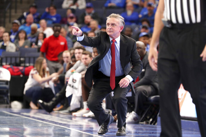 Illinois-Chicago head coach Steve McClain calls to players during the first half of an NCAA college basketball game against Memphis, Friday, Nov. 8, 2019, in Memphis, Tenn. (AP Photo/Karen Pulfer Focht)