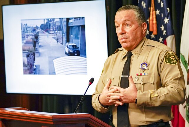 FILE - In this Sep. 17, 2020, file photo, Los Angeles County Sheriff Alex Villanueva comments on the investigation of the shooting of two deputies during a news conference at the Hall of Justice in downtown Los Angeles. A radio reporter taken into custody while covering a demonstration the night two Los Angeles County sheriff's deputies were shot will not be criminally charged. Josie Huang, a journalist for KPCC, was slammed to the ground by deputies and accused of interfering with the arrest of a protester outside a hospital Sept. 12. Sheriff Alex Villanueva said Huang was too close to the deputies. But the Los Angeles County's District Attorney's Office says