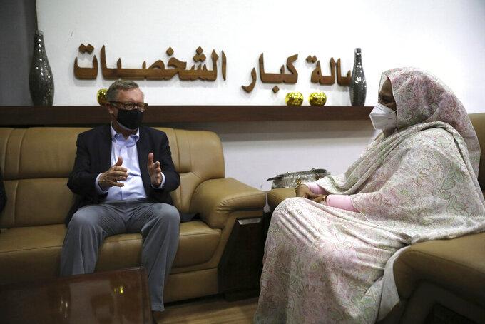 U.S. Special Envoy for the Horn of Africa Jeffrey Feltman, left, meets with Sudanese Foreign Minister Maryam al-Sadiq al-Mahdi in Khartoum, Sudan, Friday, May 7, 2021. (AP Photo/Marwan Ali)