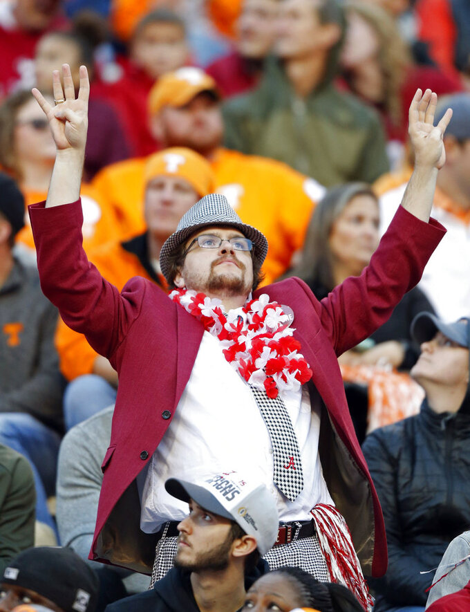 An Alabama fan signals the beginning of the fourth quarter of an NCAA college football game against Tennessee Saturday, Oct. 20, 2018, in Knoxville, Tenn. Alabama won 58-21. (AP Photo/Wade Payne)
