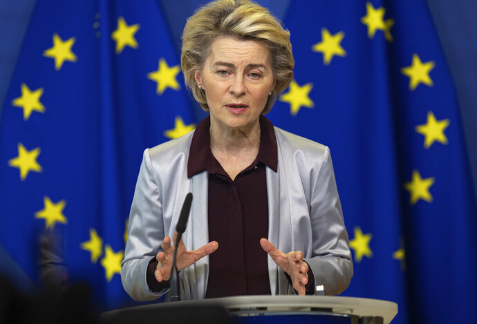 European Commission President Ursula von der Leyen delivers a statement at EU headquarters in Brussels, Tuesday, Nov. 24, 2020. The European Commission announced on Tuesday that it has approved a new contract to secure another COVID-19 vaccine for Europeans. (AP Photo/Olivier Matthys, Pool)
