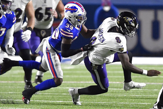 Buffalo Bills cornerback Levi Wallace (39) sacks Baltimore Ravens' Lamar Jackson (8) during the first half of an NFL divisional round football game Saturday, Jan. 16, 2021, in Orchard Park, N.Y. (AP Photo/Adrian Kraus)
