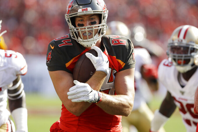 Tampa Bay Buccaneers tight end Cameron Brate (84) runs after a catch against the San Francisco 49ers during the first half an NFL football game, Sunday, Sept. 8, 2019, in Tampa, Fla. (AP Photo/Chris O'Meara)
