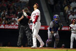 Los Angeles Angels' Shohei Ohtani reacts after being called out on strikes during the sixth inning of a baseball game against the Texas Rangers, Monday, Sept. 6, 2021, in Anaheim, Calif. (AP Photo/Marcio Jose Sanchez)
