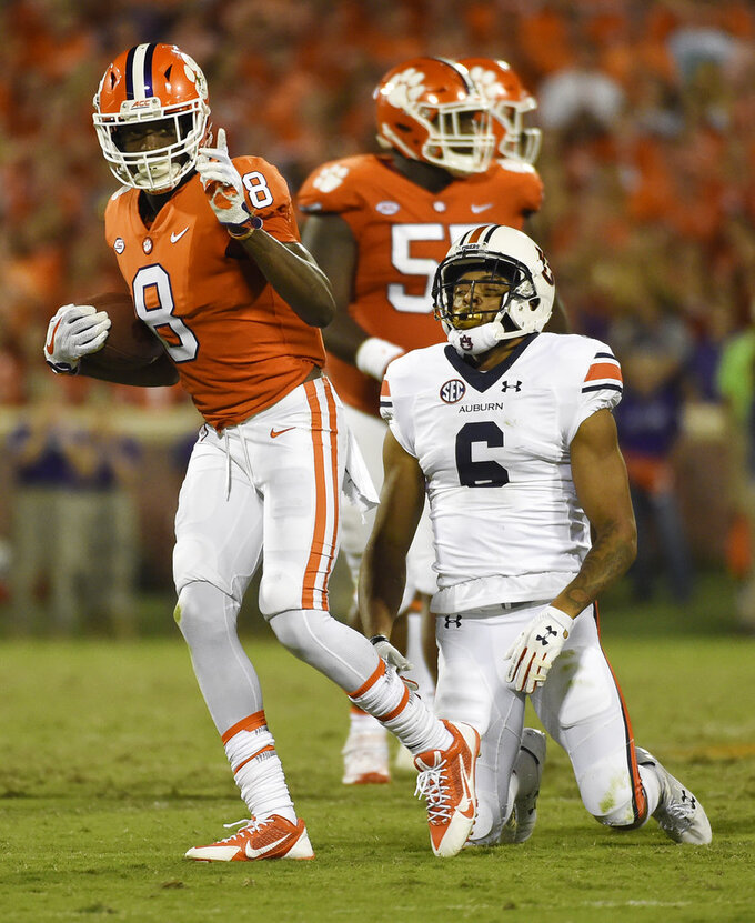 Clemson wide receiver Deon Cain (8) gestures after a catch as Auburn defensive back Carlton Davis (6) reacts during the second half of an NCAA college football game, Saturday, Sept. 9, 2017, in Clemson, S.C. (AP Photo/Rainier Ehrhardt)