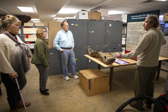 J. Terry Dougherty, curator of the Spotsylvania County Museum, gives a brief tour of the museum's collection to (from left) Karen Robison, Linda Struebing and Dennis Gallahan at the First Day of Chancellorsville Park in Spotsylvania, Va. on Wednesday, Jan. 15, 2020.(Mike Morones/The Free Lance-Star via AP)