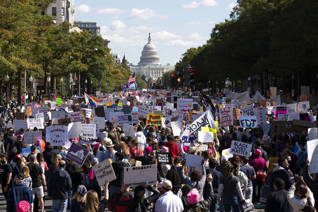 EDS NOTE: OBSCENITY - With the U.S Capitol in the back ground demonstrators march on Pennsylvania Avenue during the Women's March in Washington, Saturday, Oct. 17, 2020. (AP Photo/Jose Luis Magana)
