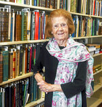 In this July 2018 photo, Patricia Rooney, who taught English at Robert Morris University, stands with some of the more than 400 books acquired by her late husband, Dan Rooney, that were donated to his alma mater, Duquesne University, at the university in Pittsburgh. Patricia Rooney, the wife of late Pittsburgh Steelers chairman Dan Rooney, has died. She was 88. The Steelers said in a statement that Patricia Rooney died peacefully at her home on Saturday, Jan. 30, 2021. A cause of death was not given. (Nate Guidry/Pittsburgh Post-Gazette via AP)