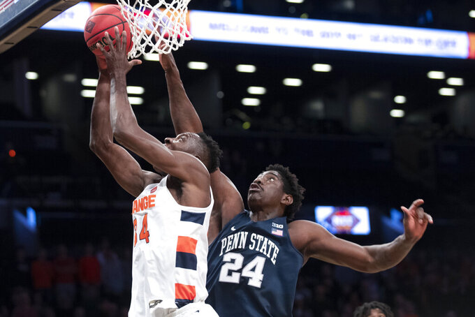 Syracuse forward Bourama Sidibe (34) shoots past Penn State forward Mike Watkins (24) during the first half of an NCAA college basketball game in the consolation round of the NIT Season Tip-Off tournament, Friday, Nov. 29, 2019, in New York. (AP Photo/Mary Altaffer)