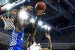 Auburn forward Danjel Purifoy (3) blocks a shot by Kentucky guard Tyrese Maxey (3) during the first half of an NCAA college basketball game Saturday, Feb. 1, 2020, in Auburn, Ala. (AP Photo/Julie Bennett)