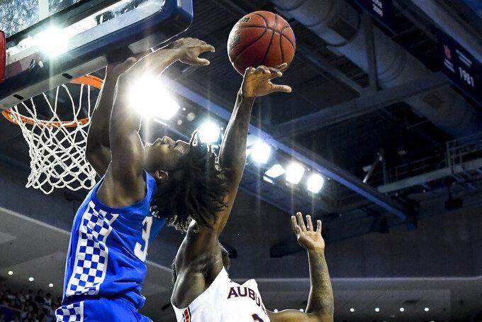 Auburn forward Danjel Purifoy (3) blocks a shot by Kentucky guard Tyrese Maxey (3) during the first half of an NCAA college basketball game Saturday, Feb. 1, 2020, in Auburn, Ala. (AP Photo/Julie Bennett)