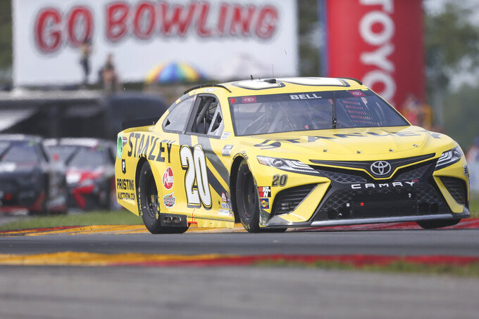 Christopher Bell drives through the Bus Stop during a NASCAR Cup Series auto race in Watkins Glen, N.Y., on Sunday, Aug. 8, 2021. (AP Photo/Joshua Bessex)