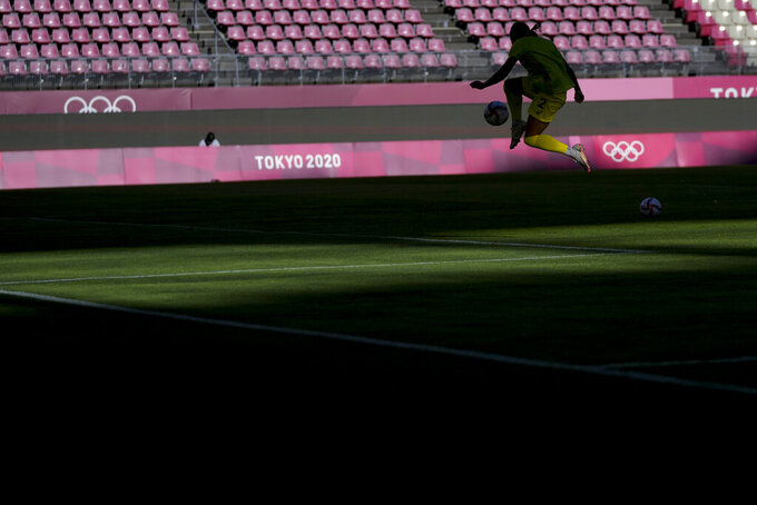 An Australian player warms up prior to the women's bronze medal soccer match against the United States at the 2020 Summer Olympics, Thursday, Aug. 5, 2021, in Kashima, Japan. (AP Photo/Fernando Vergara)