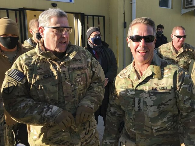Chairman of the U.S. Joint Chiefs of Staff Gen. Mark Milley, left, talks with Gen. Scott Miller, the commander of U.S. and coalition forces in Afghanistan, Wednesday, Dec. 16, 2020 at Miller's military headquarters in Kabul, Afghanistan. The top U.S. military officer has held an unannounced meeting with Taliban peace negotiators to push for a reduction in violence in Afghanistan. (AP Photo/Robert Burns)