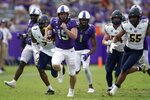 TCU quarterback Max Duggan (15) carries the ball for a long gain as California cornerback Chigozie Anusiem (7), linebacker Evan Tattersall (54) and linebacker Mo Iosefa (55) give chase in the second half of an NCAA college football game in Fort Worth, Texas, Saturday, Sept. 11, 2021. (AP Photo/Tony Gutierrez)