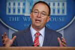 "FILE - In this Oct. 17, 2019 file photo, acting White House chief of staff Mick Mulvaney speaks in the White House briefing room in Washington. House impeachment investigators have asked Mulvaney to testify about his ""first-hand knowledge"" of President Donald Trump's dealings with Ukraine. (AP Photo/Evan Vucci)"