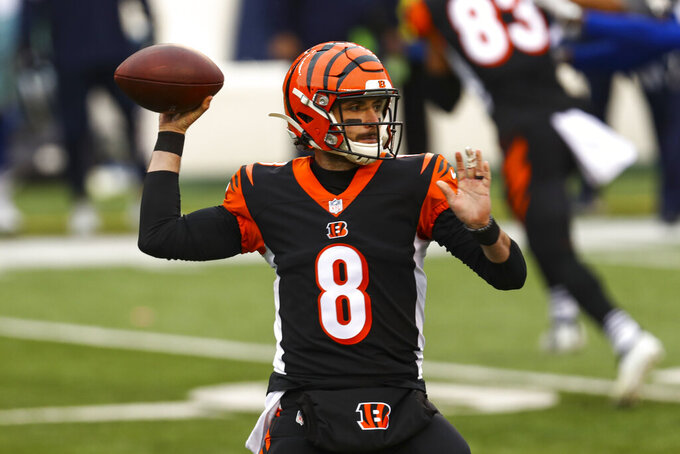 Cincinnati Bengals quarterback Brandon Allen (8) throws against the Dallas Cowboys in the first half of an NFL football game in Cincinnati, Sunday, Dec. 13, 2020. (AP Photo/Aaron Doster)