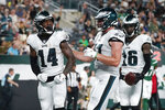 Philadelphia Eagles' Kenneth Gainwell (14) celebrates with teammates Jack Stoll (47) after scoring a touchdown during the first half of an NFL preseason football game against the New York Jets Friday, Aug. 27, 2021, in East Rutherford, N.J. (AP Photo/John Minchillo)