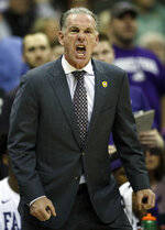TCU head coach Jamie Dixon yells at an official during the first half of an NCAA college basketball game against Kansas State in the quarterfinals of the Big 12 conference tournament in Kansas City, Mo., Thursday, March 14, 2019. (AP Photo/Orlin Wagner)