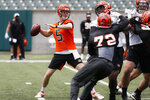 Cincinnati Bengals quarterback Ryan Finley throws during practice at the team's NFL football facility, Wednesday, June 12, 2019, in Cincinnati. (AP Photo/John Minchillo)