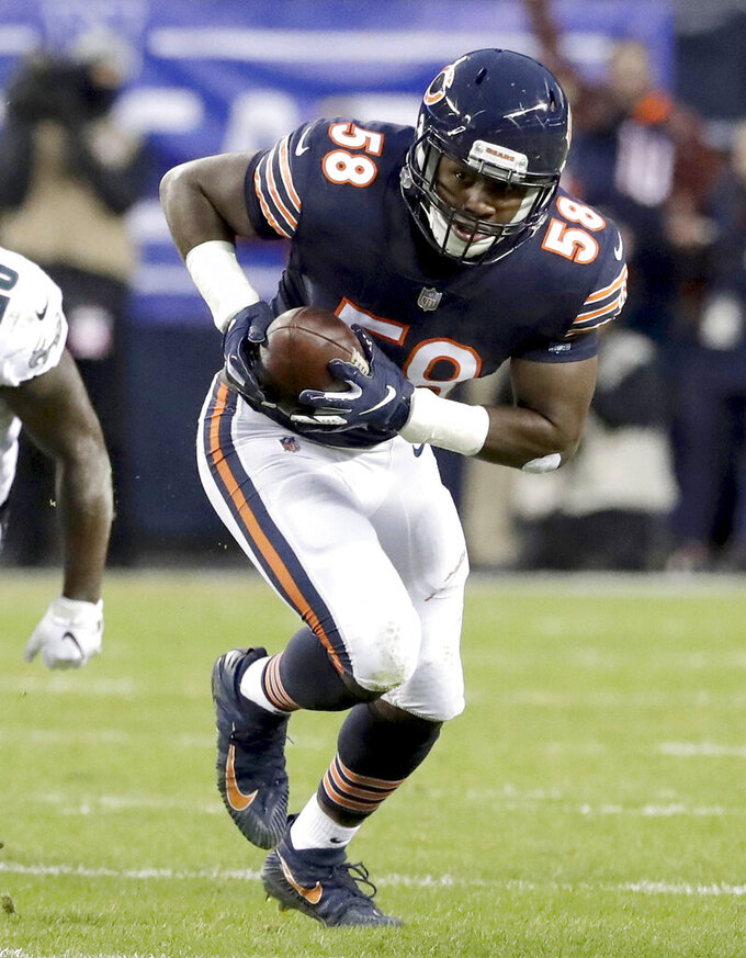 FILE--In this Jan. 6, 2019, file photo, Chicago Bears linebacker Roquan Smith (58) runs after intercepting a pass during the first half of an NFL wild-card playoff football game against the Philadelphia Eagles, in Chicago. The Chicago Bears announced Tuesday, April 23, 2019, that veteran defensive tackle Akiem Hicks and rookie linebacker Roquan Smith were selected by their teammates as the 2018 Piccolo Award winners. The Piccolo Award has been given to a Bears rookie every season since 1970 in memory of Brian Piccolo. In 1992, the award was expanded to include a veteran as well. (AP Photo/Nam Y. Huh, File)