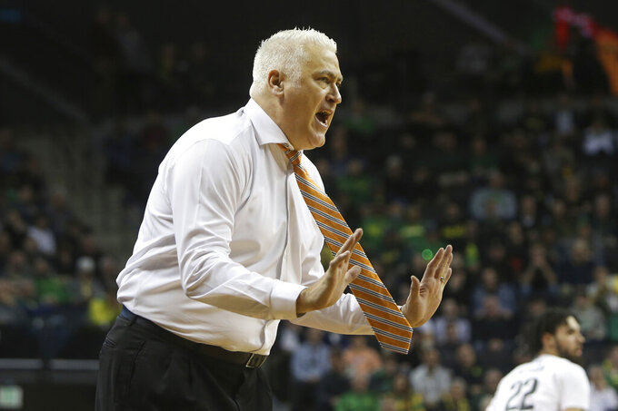 Oregon State coach Wayne Tinkle calls to the team during the second half of an NCAA college basketball game against Oregon in Eugene, Ore., Thursday, Feb. 27, 2020. (AP Photo/Chris Pietsch)
