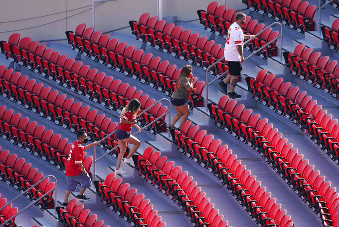 Fans arrive at Arrowhead Stadium before an NFL football game between the Kansas City Chiefs and the Las Vegas Raiders, Sunday, Oct. 11, 2020, in Kansas City. (AP Photo/Charlie Riedel)