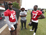 Atlanta Falcons linebacker Deion Jones (45) shares a laugh with safety Damontae Kazee (27) after NFL football practice in Flowery Branch, Ga., Wednesday, June 12, 2019. (Curtis Compton/Atlanta Journal-Constitution via AP)