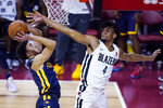 Portland Trail Blazers' Greg Brown III, right, fouls Indiana Pacers' Chris Duarte during the first half of an NBA summer league basketball game Thursday, Aug. 12, 2021, in Las Vegas. (AP Photo/John Locher)