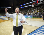 Wofford coach Mike Young pumps his fist as he leaves the court after the team's 84-68 win over against Seton Hall in a first-round game in the NCAA men's college basketball tournament in Jacksonville, Fla. Thursday, March 21, 2019. (AP Photo/Stephen B. Morton)