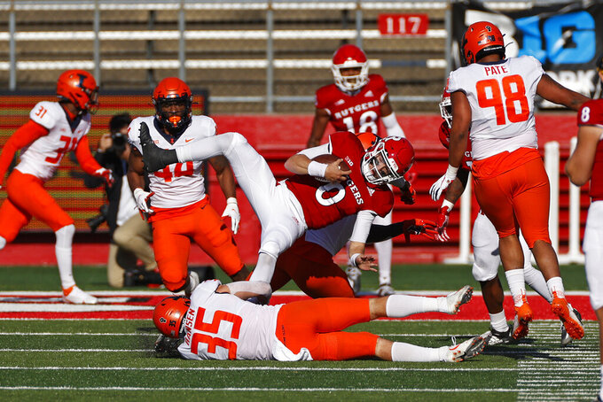 Rutgers quarterback Noah Vedral (0) is tackled by Illinois linebacker Jake Hansen (35) during the first half of an NCAA college football game Saturday, Nov. 14, 2020, in Piscataway, N.J. (AP Photo/Adam Hunger)
