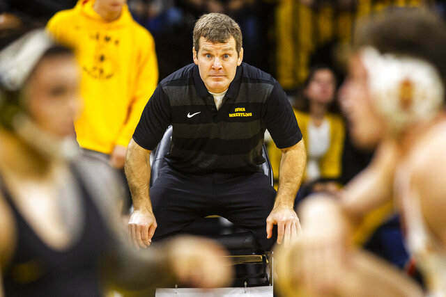 FILE - In this Dec. 1, 2018, file photo, Iowa coach Tom Brands watches during a 149-pound bout between Iowa's Pat Lugo and Iowa State's Jarrett Degen at an NCAA college wrestling meet in Iowa City, Iowa. Brands has received a contract extension through the 2026 season. (Joseph Cress/Iowa City Press-Citizen via AP, File)