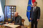 President of the European Council Charles Michel, left, signs the guest book at the government building as Croatia's prime minister Andrej Plenkovic looks on, in Zagreb, Croatia, Thursday, Jan. 9, 2020. Croatia took over the presidency of the Council of the European Union on Jan. 1, 2020 from Finland, six and a half years after entering the European bloc. (AP Photo/Darko Bandic)