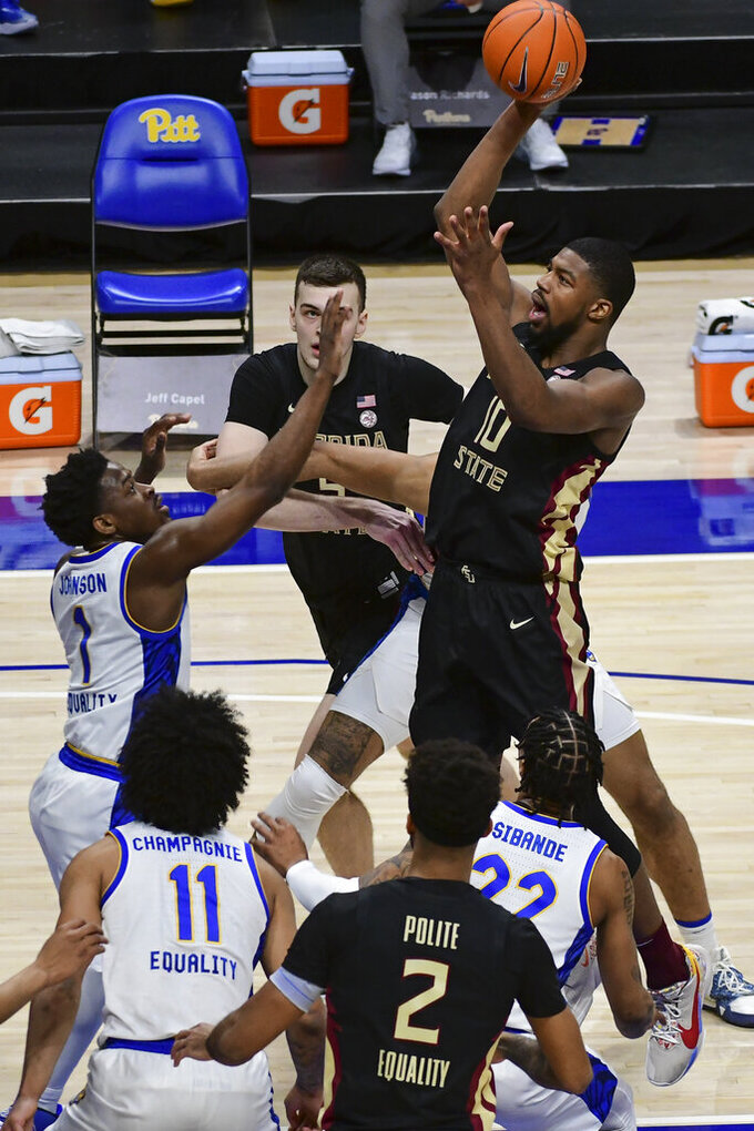 Florida State forward Malik Osborne goes up for a shot against Pittsburgh during the first half of an NCAA college basketball game, Saturday, Feb. 20, 2021, in Pittsburgh. (AP Photo/Fred Vuich)