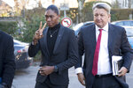 South Africa's runner Caster Semenya, left, current 800-meter Olympic gold medalist and world champion, and her lawyer Gregory Nott, right, arrive for the first day of a hearing at the international Court of Arbitration for Sport, CAS, in Lausanne, Switzerland, Monday, Feb. 18, 2019. Semenya has filed an appeal in the CAS against the International Association of Athletics Federations (IAAF) ruling, forcing female runners to medicate to reduce their testosterone levels for six months before racing internationally. (Laurent Gillieron/Keystone via AP)