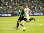 Austin FC forward Sebastian Driussi, front, takes a shot on goal while defended by Los Angeles FC midfielder Daniel Crisostomo, back, during the first half of an MLS soccer match, Wednesday, Sept. 15, 2021, in Austin, Texas. Driussi was called off-sides on the play. (AP Photo/Michael Thomas)