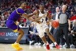 Cincinnati's Keith Williams (2) drives against East Carolina's J.J. Miles, left, during the first half of an NCAA college basketball game, Sunday, Jan. 19, 2020, in Cincinnati. (AP Photo/John Minchillo)
